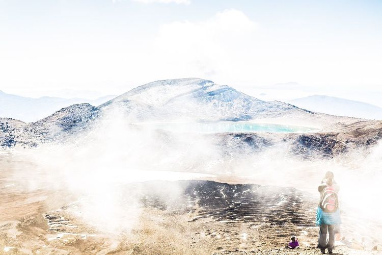 National park, Tongariro crossing Real People One Person Leisure Activity Day Casual Clothing Sky Mountain Nature Outdoors Lifestyles Rear View Standing Vacations Beauty In Nature Water Adventure Scenics Landscape Women Clear Sky Breathing Space