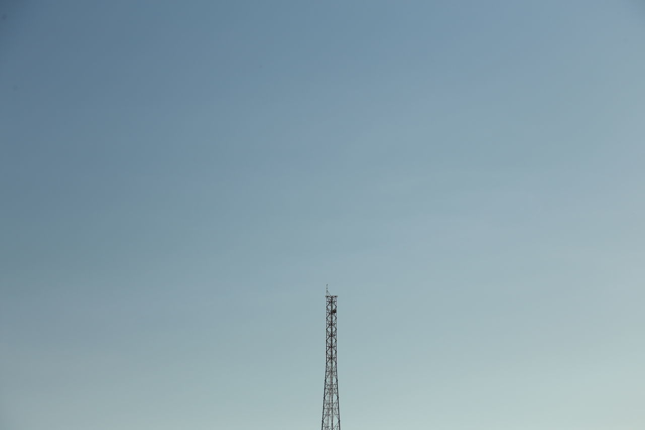 Minimal sky. Minimal Tall - High Tower Skyscraper Skyline Downtown Cityscape Industrial Windmill Electricity Tower Urban Skyline Office Building Building Story