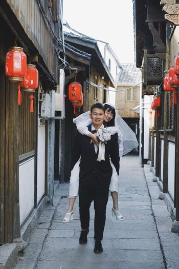 Alley Wedding Bride Bridegroom Architecture Building Exterior Built Structure Full Length Front View Real People Building Street Lifestyles Looking At Camera Portrait Outdoors