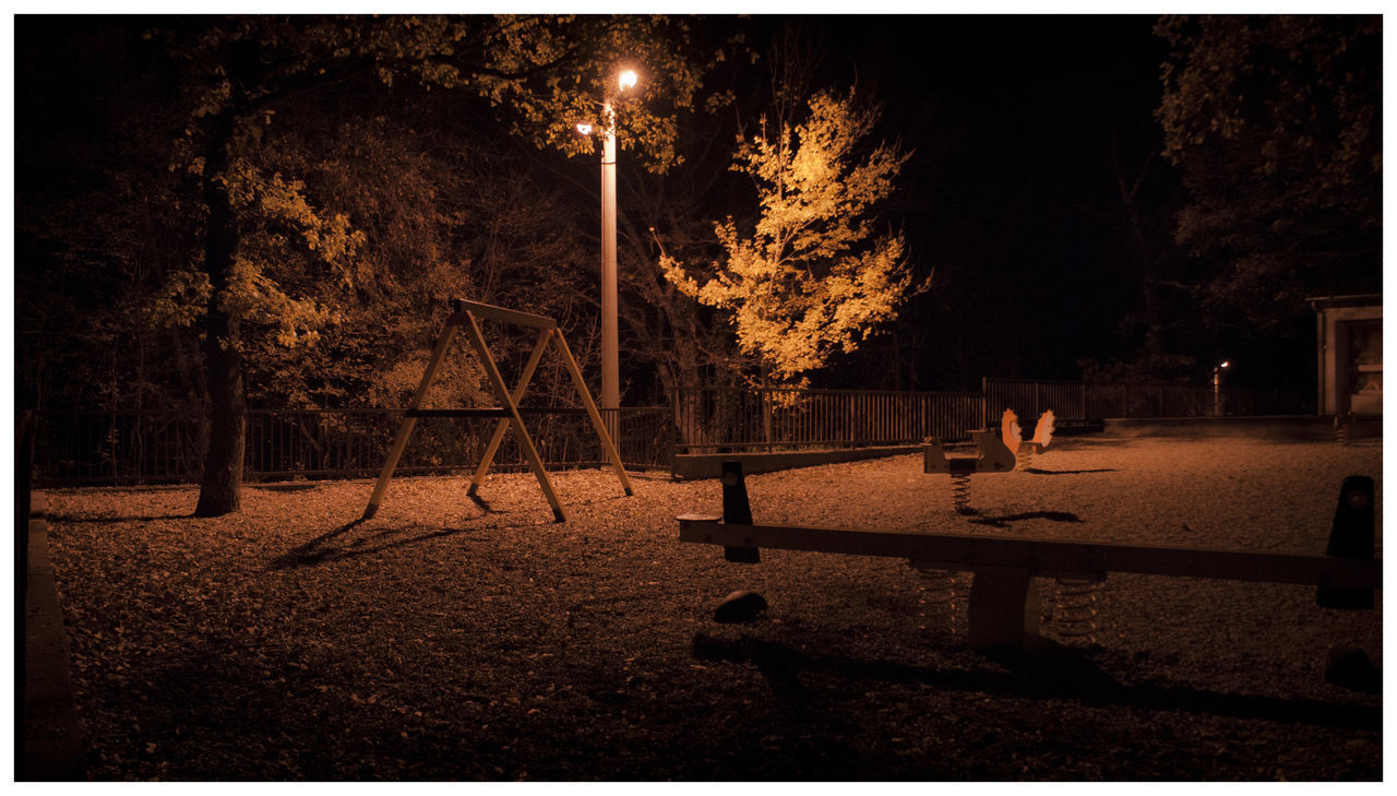 night, outdoors, real people, tree, childhood, full length, playing, one person, standing, men, illuminated, nature, people