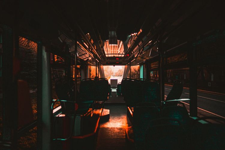 Empty chairs in illuminated room