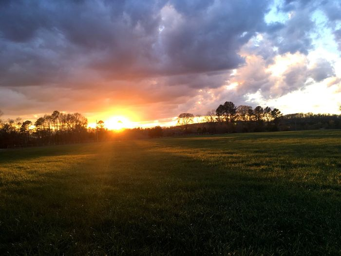 Scenic view of dramatic sky over landscape