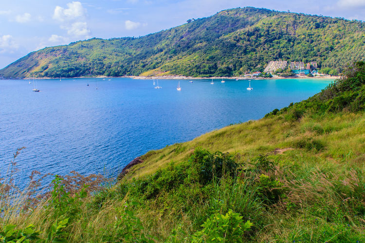 Beautiful seascape view of phuket cliff and small islands nearby Promthep cape, the most beautiful sunset viewpoint in Phuket, Thailand. Coastline Coastline Landscape Coastline Landscape Blue Beach Sea Outdoors Sky Scenics Real People Nature Day Water Coastline Nature Water Grass Sea Sky PromThepCape Promthep Cape Aerial View Cliff View Cliffs And Water Cliffside Coastline Beauty Coastline Sky Grass And Sky Promthep Small Island Small Islands Viewpoint