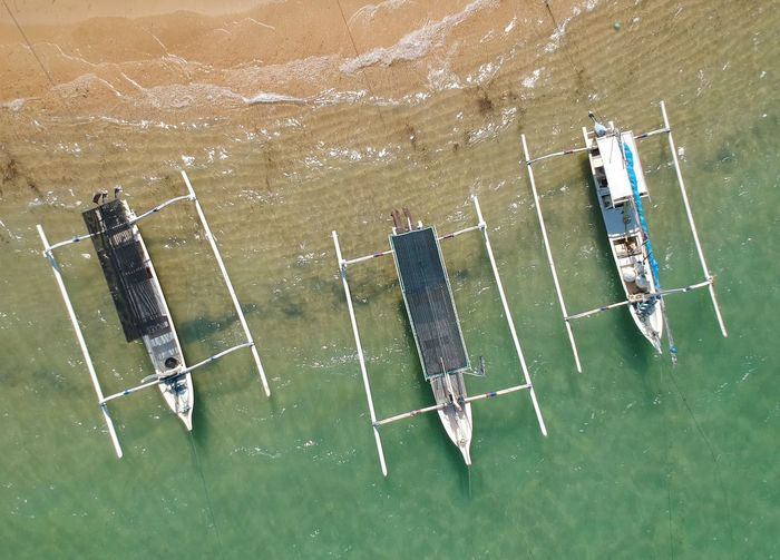 High angle view of outriggers in sea