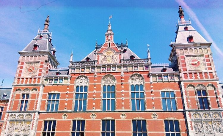 Architecture Building Exterior Travel Destinations Clock Red Government Built Structure City Flag Sky No People Clock Tower Outdoors Day Amsterdam Amsterdam City Beauty In Nature Landscape Architecture Amsterdamlife Amsterdam Canal