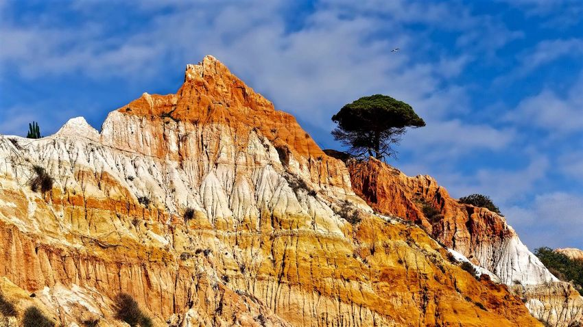 Olhos de Água cliffs 🇵🇹 EyeEm Selects Mountain Nature Rock Formation Rock - Object Beauty In Nature Physical Geography Scenics Day Sky Outdoors Low Angle View Tranquility Peak Cloud - Sky No People Mountain Range Cliff Rocky Mountains