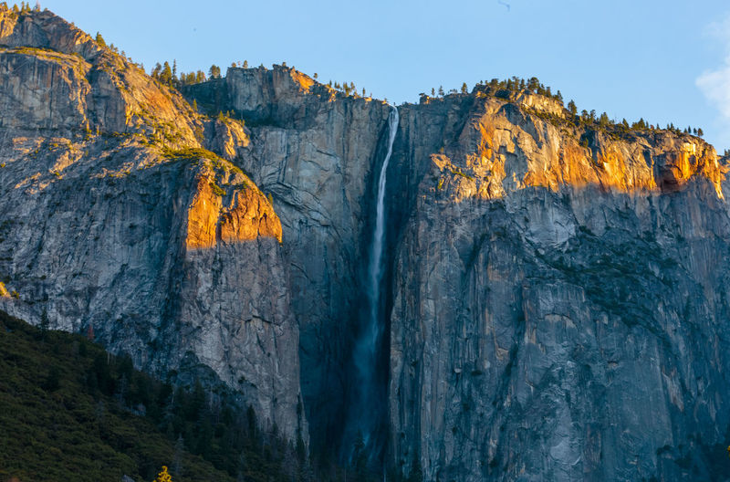 Sunlight in Yosemite National Park Nature Sunlight Beauty In Nature Cliff Day Golden Hour Mountain Nature No People Steep Sunrise Waterfall