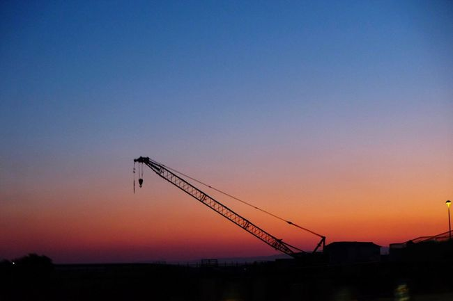 Construction site Sunset Silhouette Development Construction Site Crane Crane - Construction Machinery Sky Construction Site Evening Sky Blue Clear Sky Nature Beauty In Nature Architecture