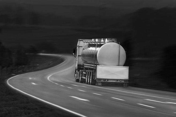 Black and white image with tanker truck driving on a countryside road, outside the german city Schwabisch Hall, Baden Wurttemberg, Germany Delivery Motion Blur Black And White Cargo Monochrome Motion Road Speed Street Tanker Truck Transportation Truck