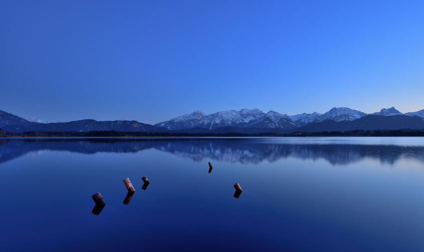 Silent atmosphere at Blue Hour on The Beach and View to Bavarian Alps Reflection Water Nature Sky Blue Enjoying Life Outdoors Tranquility Lake Blue Hour Waterfront Mystic Nature Lanscape Photography Lake View Travel Photography Beauty In Nature Panoramic View No People Landscape_Collection EyeEm Nature Lover Panoramic Photography Silent Moment Longtimeexposure Copy Space Blue Color Silence Of Nature Tranquil Scene Mountain Range Atmospheric Mood Vertebrate Atmospheric Nature Scenics - Nature Gorgeous Nikonphotography Nikondeutschland