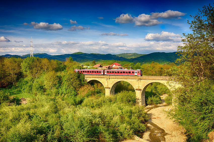 Train on Bridge Arch Beauty In Nature Bridge - Man Made Structure Built Structure Cloud Cloud - Sky Connection Green Green Color HDR HDR Collection Hdr Edit Hdr_Collection Hdrphotography Landscape Mountain Mountain Range Nature No People Non-urban Scene Outdoors Sky Train Train Tracks Tree