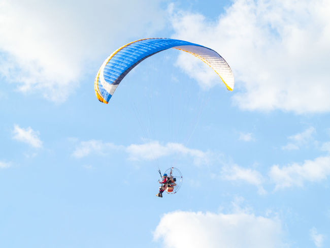 Adventure Adventure Sports Aereal View Day Extreme Extreme Sport Extreme Sports Flying Flying High Leisure Activity Lifestyles Man Mid-air Nature One Person Outdoors Parachute Paraglider Paragliding People Real People Sky Sky And Clouds Sport TCPM