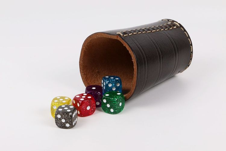 dice cup with six colored dices on the table Eyeem Games Happiness Leather Luck Playing Games Sparkle Würfel  Würfelbecher Yatzee Yatzy Colorful Cup Dice Dices Game Leder Multi Colored Playing Shaker Studio Shot Throwing  White Background