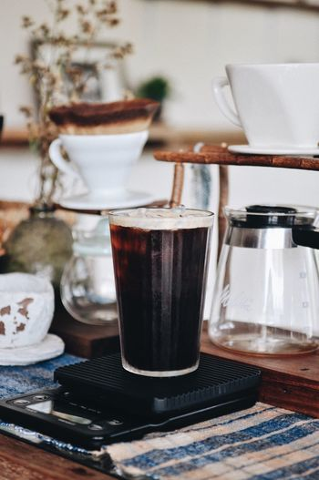 Close-up of iced coffee in glass on table at home