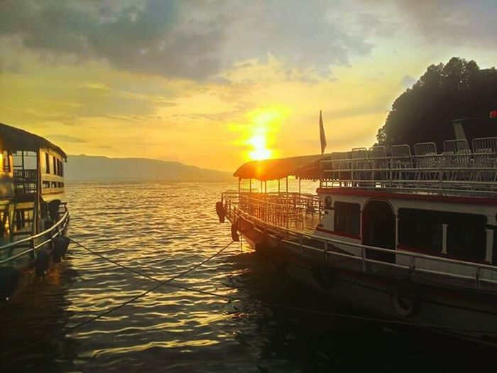 sunset lake toba, indonesia Water Nautical Vessel Sea Sunset Beach Boat Deck Yacht Sunlight Sun Dawn First Eyeem Photo The Great Outdoors - 2018 EyeEm Awards