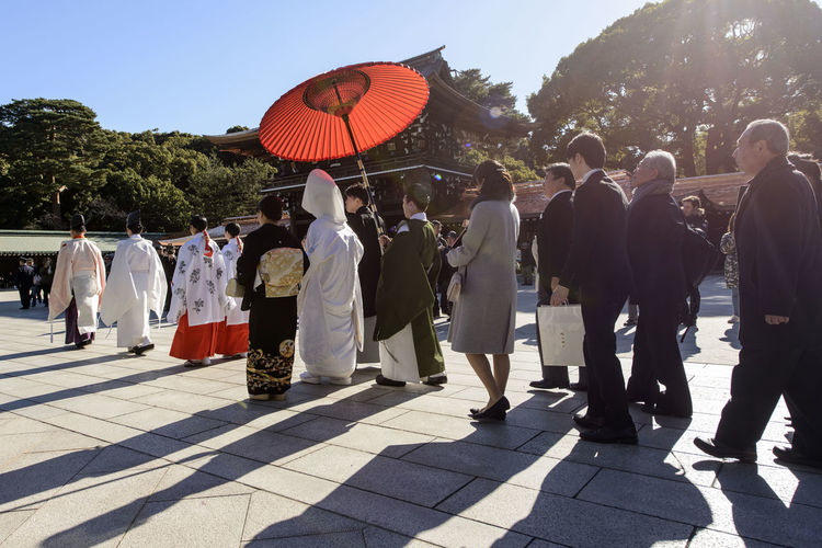 Adult Adults Only Bride Bride And Groom Ceremony Day Full Length Japan Japanese Culture Japanese Wedding Large Group Of People Men Outdoors People Place Of Worship Red Umbrella Sky Temple Tokyo Tree Wedding Wedding Ceremony Young Adult