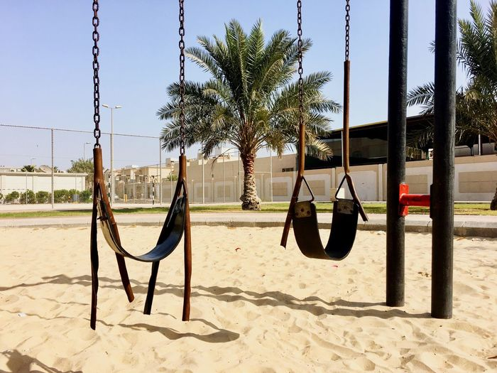 Childhood Sand Playground Tree Outdoor Play Equipment Hanging Day Swing No People Palm Tree Outdoors Clear Sky Sky Eye4photography  Saudi Arabia