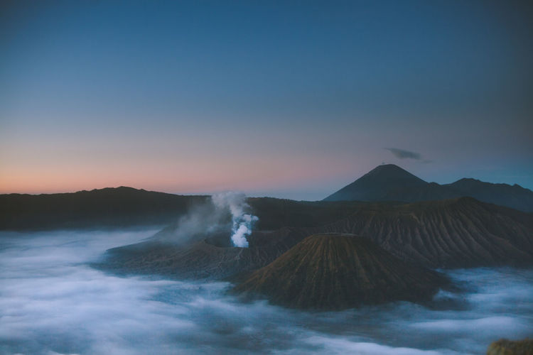 Beauty In Nature Environment Geology Idyllic Land Landscape Mountain Nature No People Non-urban Scene Outdoors Physical Geography Power In Nature Scenics - Nature Sky Smoke - Physical Structure Sunset Tranquil Scene Tranquility Travel Destinations Volcanic Crater Volcano