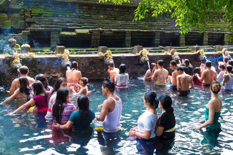 Bali, Indonesia - May 1, 2017: Tirta Empul Temple is a Hindu Balinese water temple famous for its holy spring water, where Balinese Hindus go for ritual purification near Tampaksiring, Bali, Indonesia. For editorial use only Bali Celebration Hinduism Holy Spring INDONESIA Ritual Tampaksiring Tirta Empul Tirta Empul Temple Tradition Balinese Belief Ceremony Culture Cultures Editorial  Holy Holy Place Purification Purification Ritual Religion Rituals Spring Temple Water
