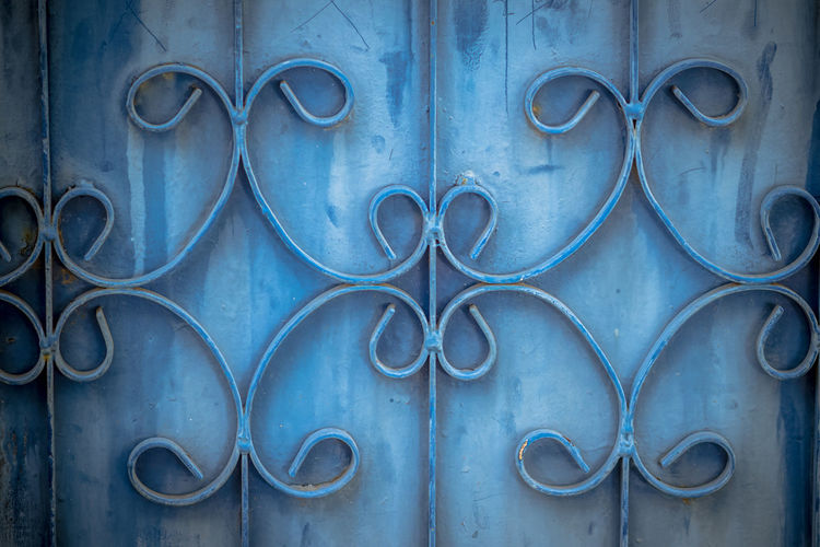 Old wrought iron bars on the gate with grunge and rusty steel background. Iron Grill Ornamental Flourish Detail Background. The old rusty fence with metallic gate pattern, curved steel background. Wrought Iron Fence Wrought Iron And Welded Wrought Iron Wrought Iron Art Wrought Iron Design Wrought Iron Fencing Wrought Iron Gate Wrought Iron Gates Wrought Iron Patio Furniture Wrought Iron Railing Wrought Iron Railings Wrought Iron Rust Wrought-iron Wroughtiron