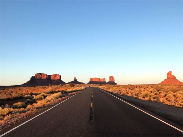 Run forrest run Cowboy USA Monument Valley Roadtrip Sky Direction The Way Forward Clear Sky Copy Space Road Diminishing Perspective Nature Landscape Built Structure Architecture vanishing point No People Day Summer Road Tripping