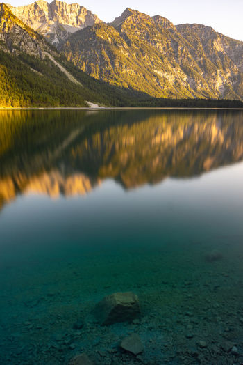 Mountain reflections in a lake Water Mountain Scenics - Nature Lake Beauty In Nature Tranquility Tranquil Scene Nature No People Reflection Non-urban Scene Day Mountain Range Idyllic Waterfront Outdoors Environment Remote Rock