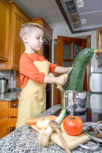 Boy holding food at home