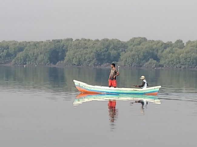 Water Nautical Vessel Transportation Mode Of Transportation Waterfront Lake Reflection Two People Nature Men Real People Day Beauty In Nature People Leisure Activity Sitting Tranquility Non-urban Scene Sky Outdoors Inflatable