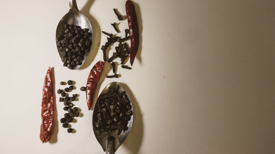Clove, pepper and dried chilli Knolling Styled Stock Photos Flat Lay Minimalism Copy Space Textures and Surfaces Spoonful Low Light Photography Low Light Cooking Ayurvedic Alternative Medicine Black Peppercorns Clove Dried Chillies Cooking Ingredient Seasoning Flavours Of India