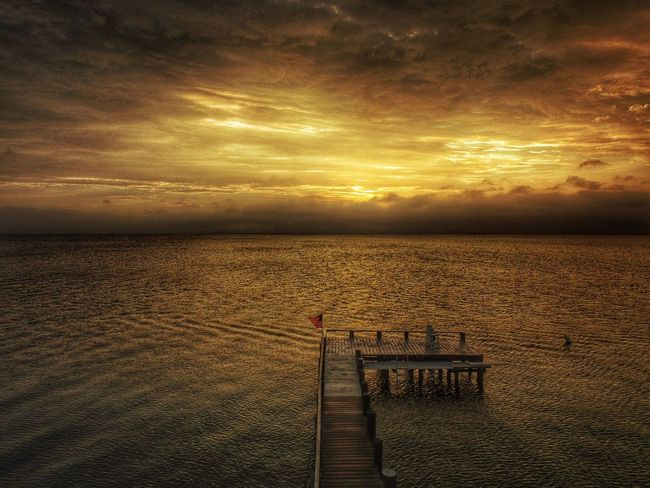 A Bird's Eye View a good place to land. Water Sea Horizon Over Water Tranquil Scene Cloud - Sky Jetty Nature Seascape Sunrise Tranquility High Angle View