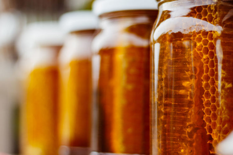 Close-up of honey in glass jars