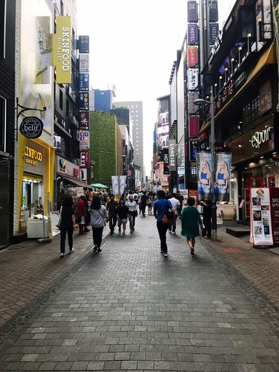 City Life Walking City Large Group Of People Street Architecture Building Exterior Pedestrian Crowd Outdoors Men People Day Modern Adult Adults Only Seoul South Korea