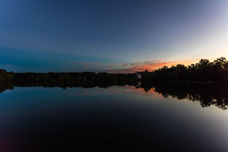 Sunset over the Ocmulgee River Beauty In Nature Blue Calm Cloud Countryside Idyllic Lake Majestic Nature No People Non-urban Scene Outdoors Outline Reflection Remote Scenics Silhouette Sky Standing Water Sunset Tranquil Scene Tranquility Tree Water Waterfront