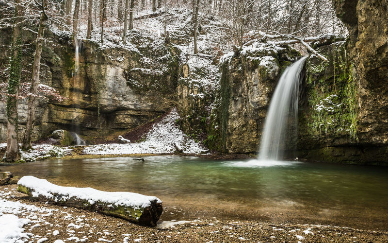 Winteridylle Waterfall Snow Winter Cold Water Long Exposure Falling Water Forest Rock Trees Trunk Nature Landscape Outdoors Flowing Water Beauty In Nature Flowing Blurred Motion Scenics - Nature