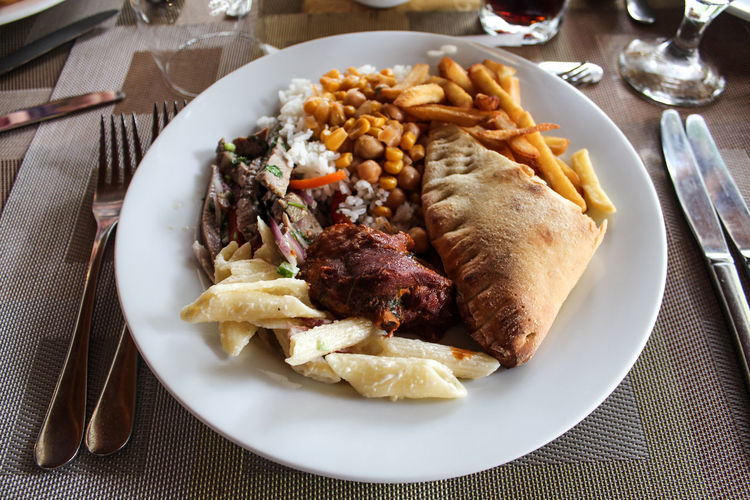 Plate full of food Pie Food Vacations Party Dish Plate Knife Drink Corn Macarons Meat! Meat! Meat! Restaurant Plate Fork Food And Drink Fried Potato Deep Fried  French Fries