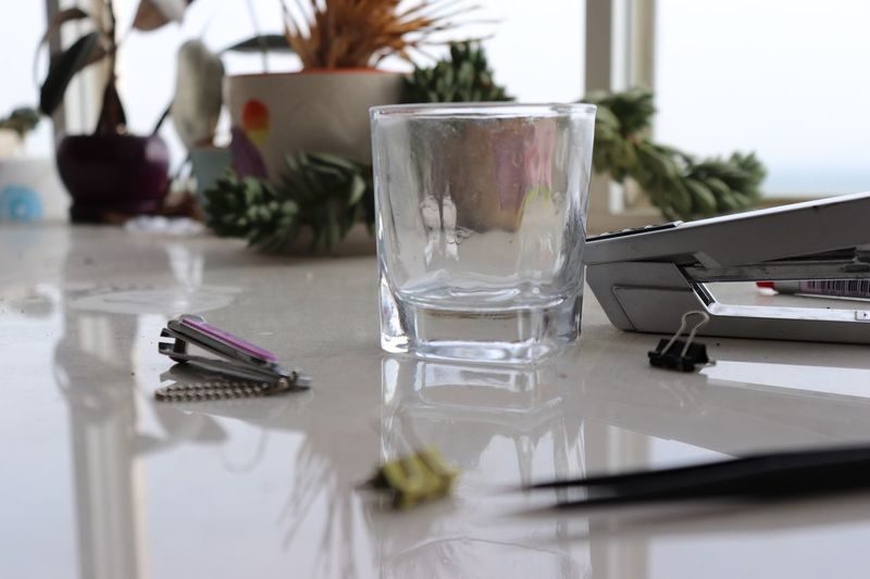 Glass EyeEm Selects Table Glass Indoors  Household Equipment Glass - Material Drinking Glass Still Life Water Close-up Food And Drink No People Refreshment Drink Focus On Foreground Transparent Selective Focus Reflection Setting Container Nature