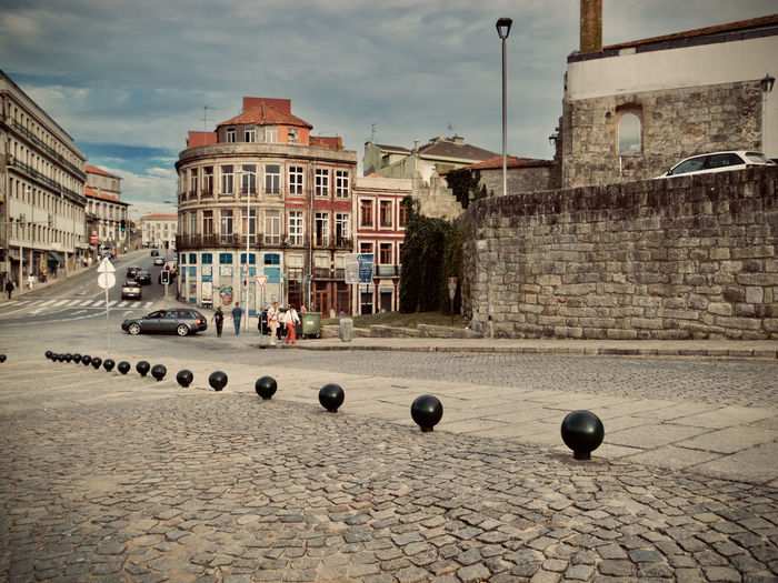 City Cityscape Oporto, Portugal Portugal Architecture Building Building Exterior Built Structure Car City Cloud - Sky Cobblestone Color Day Mode Of Transportation Motor Vehicle Nature No People Outdoors Residential District Sky Street Town Transportation