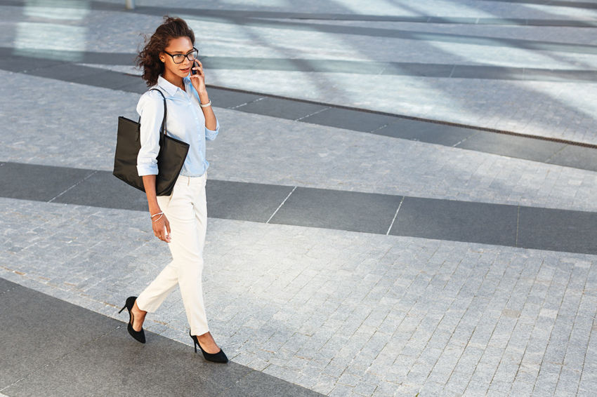 Business Woman Mobile Phone Wireless Technology Using Phone Technology Smart Phone Communication One Person Connection Outdoors Corporate Eyeglasses  Walking Holding Talking