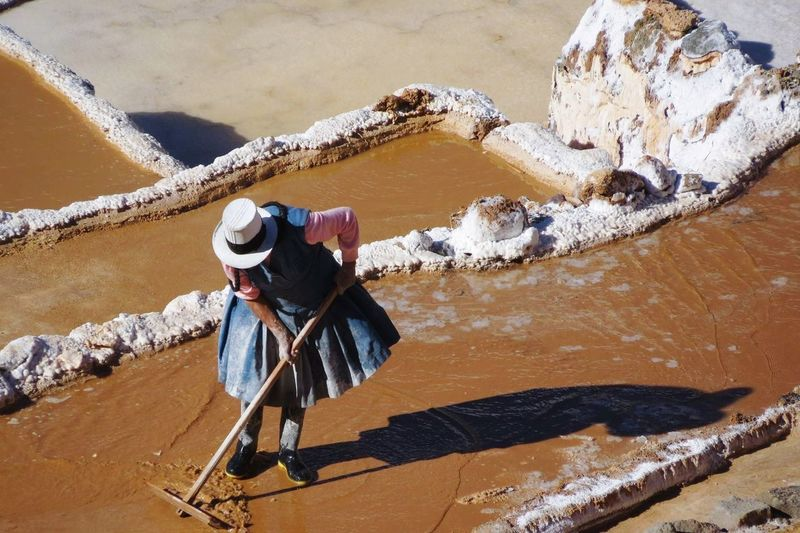 High angle view of woman working at salt flat