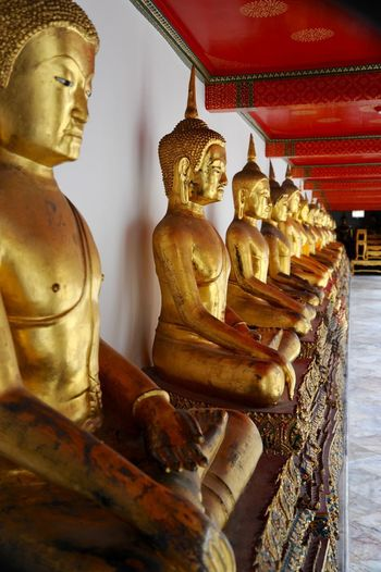 Buddhist Temple Thai Buddha Representation Religion Human Representation Sculpture Statue Male Likeness Art And Craft Spirituality Gold Colored Place Of Worship Architecture Built Structure No People Idol Creativity Indoors  Building Belief
