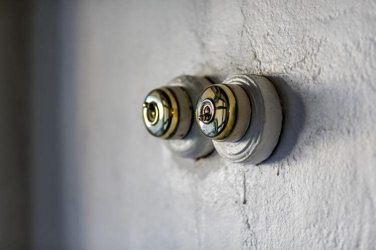 Knobs on white wall