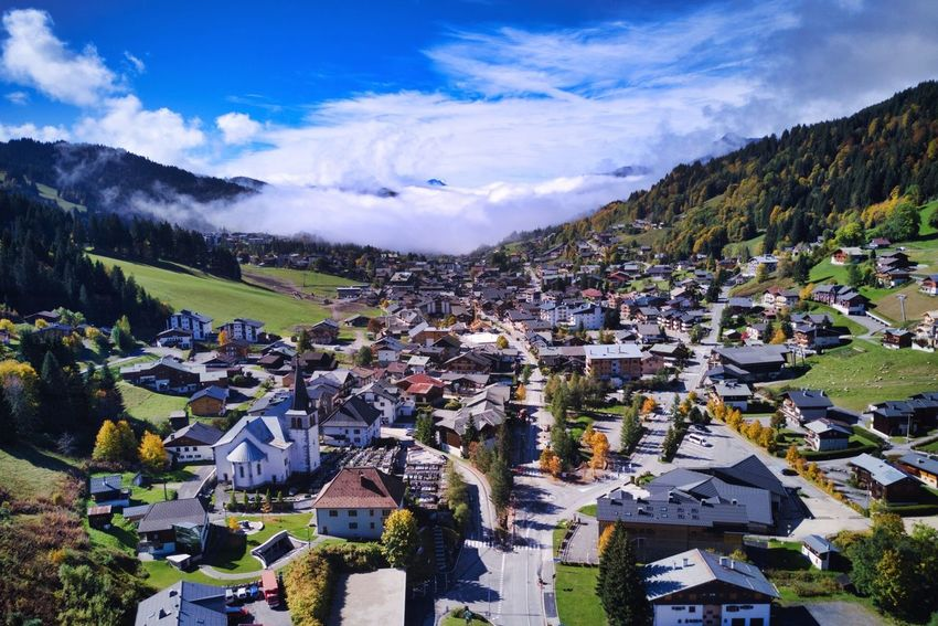 Village Montagne Automne AlpesFrancaises Eglise Nuage Les Gets Alpes DJI Mavic Pro Luminar Soleil Jaune Orange Station De Ski Portes Du Soleil Col De Montagne Chalets Remontés Mécaniques Architecture Nature Outdoors High Angle View Day Beauty In Nature Mountain Range