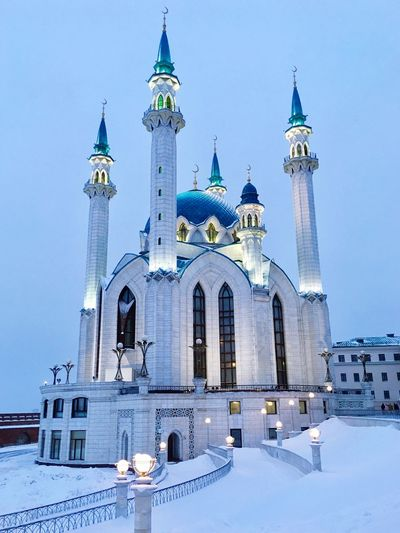Low angle view of qol?ärif mosque against sky during winter