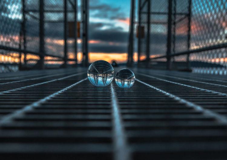 Lensball shot on metal bridge