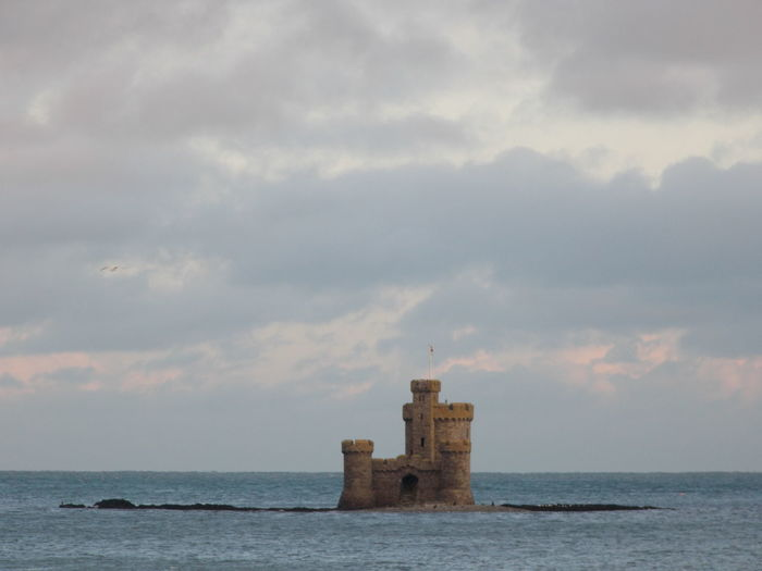 Architecture Beauty In Nature Building Exterior Built Structure Cloud Cloud - Sky Cloudy Guidance Hope In The Ocean Horizon Over Water Idyllic Kiomi Collection Little Castle On Its Own Island Nature Outdoors Real Castle Scenics Sea Sky Small Island Tranquil Scene Tranquility Water Waterfront Winter