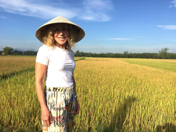 Tourist In Rice Field Coolie Straw Sun Hat EyeEm Selects Agriculture Nature One Person Real People Looking At Camera Sky Day Rural Scene