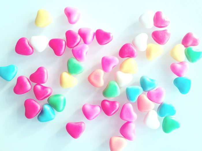 Close-Up Of Heart Shaped Candies Against White Background