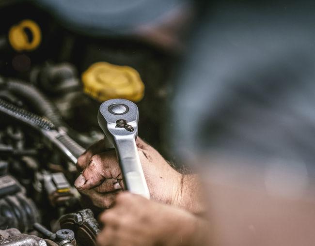 mechanic working in auto repair shop Mechanic Automobile Repair Shop Motor Car Workshop Service Garage Maintainance Automotive Authentic Oil DIY Hand Engine Inspection