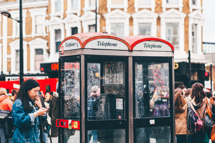 City Day Mobile Phone Pay Phone Red Phone Booth Red Phone Boxes Telephone Booth Telephone Cabin The Photojournalist - 2017 EyeEm Awards The Street Photographer - 2017 EyeEm Awards Young Adult EyeEm LOST IN London Postcode Postcards