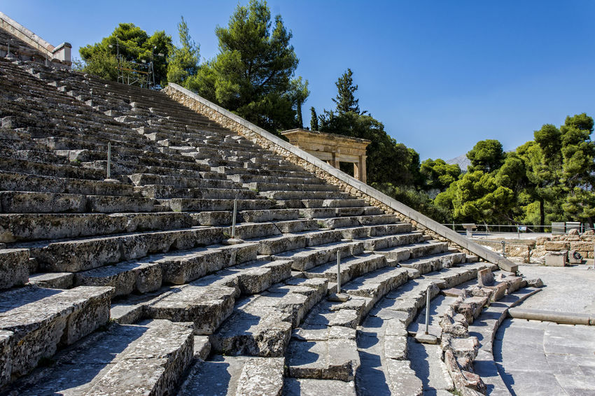 Epidaurus Ancient Ancient Civilization Architecture Building Exterior Built Structure Day Epidaurus; Argolida; Peloponnese; Greece; Ancient; Culture; Theatre; Summer; Theater; Argolis; Epidavros; Background; Landscape; Architecture; Antique; Stone; Classic; Classical; Stage; Panoramic; Marble; Greek; Ruin; Steps; Stairs; Amphitheater Greece History Nature No People Outdoors Peloponnese Sky Staircase Steps Steps And Staircases Tree